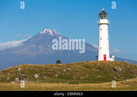 Cape Egmont Lighthouse with Mount Taranaki, Pungarehu, Taranaki Region, New Zealand - Stock Photo