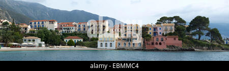 The houses in Assos, Kefalonia overlooking the harbour. - Stock Photo