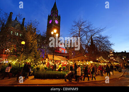 Christmas Market in front of The Town Hall, in Albert Square, Manchester, England. - Stock Photo
