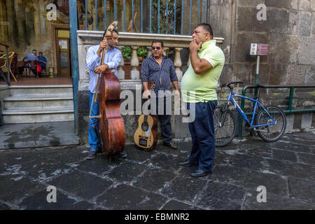 Street musicians stop for a break on the street in Sorrento, Campania, Italy - Stock Photo