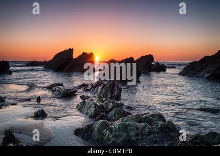 Sunset at Sharrow beach on Whitsand Bay in Cornwall - Stock Photo