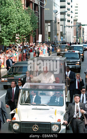 Pope John Paul II waves from inside the popemobile during his visit October 8, 1995 in Baltimore, Maryland. - Stock Photo