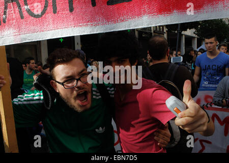 Athens, GREECE. 3rd Dec, 2014. High school students shout slogans as they march in central Athens. The students - Stock Photo