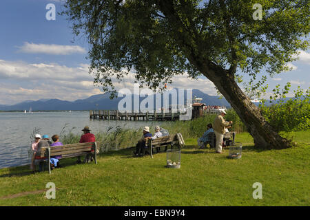 tourists at the shore of the Fraueninsel in Lake Chiemsee, Germany, Bavaria - Stock Photo