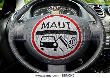 car toll sign on steering wheel, Germany - Stock Photo
