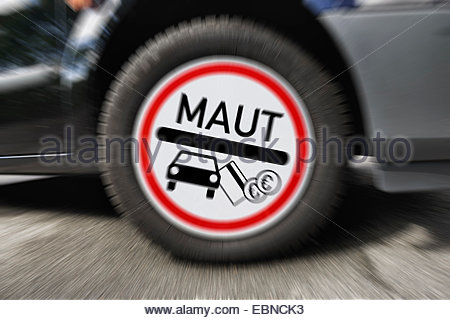 car toll sign on wheel rim, Germany - Stock Photo