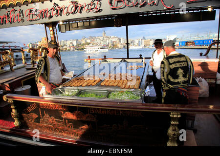 ship with fast food and fish in harbour, Turkey, Istanbul - Stock Photo