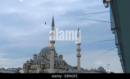 New Mosque, Yeni Cami and Galata Bridge with fishing rods, Turkey, Istanbul - Stock Photo