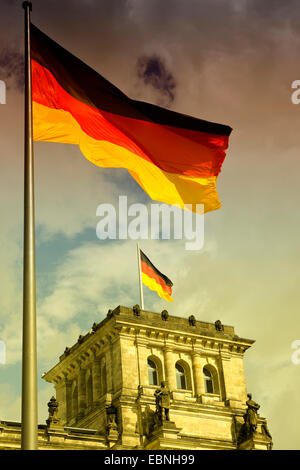 German flag blowing on Reichstag, Germany, Berlin - Stock Photo