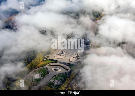 aerial view through clouds to Herrenchiemsee Palace, Germany, Bavaria, Lake Chiemsee - Stock Photo
