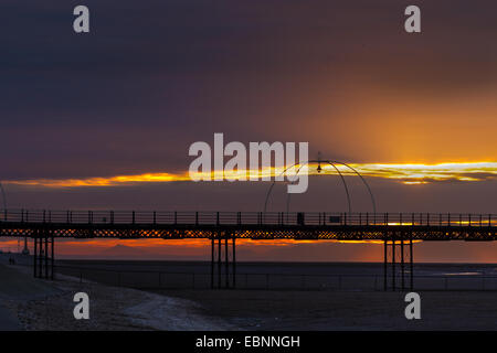 Southport, Merseyside, UK. 3rd December, 2014.  UK Weather.  Sunset silhouetting Southport's pier structure on the - Stock Photo