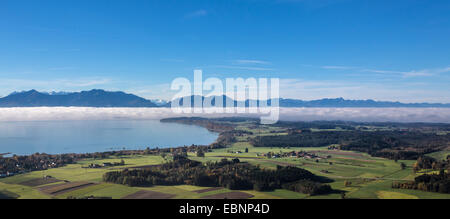 view to lake Chiemsee with low stratus, the Alps in background, Germany, Bavaria, Lake Chiemsee - Stock Photo