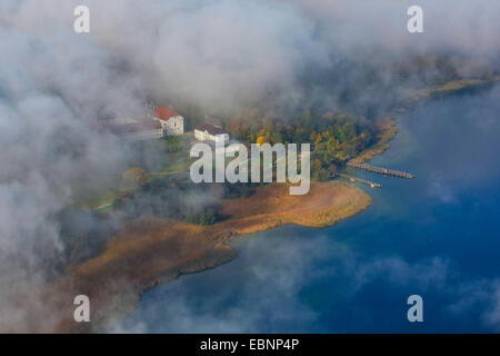 aerial view through the clouds to island Herreninsel with Old Palace and footbridge, Germany, Bavaria, Lake Chiemsee - Stock Photo