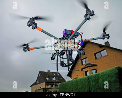 civile drone flying on the edge of a residential area, Germany - Stock Photo