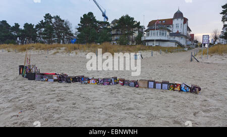 lined up Sylvester trash at the New Year's Day on the beach, Germany, Mecklenburg-Western Pomerania, Ruegen - Stock Photo