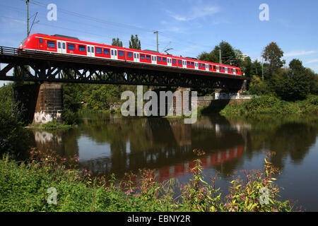 S-Bahn ET 422 on historical railway bridge, Germany, North Rhine-Westphalia, Ruhr Area, Essen - Stock Photo