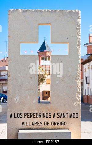 Way of St. James, cross with church, Spain, Castile and Leon, Leon, Villares de Orbigo - Stock Photo