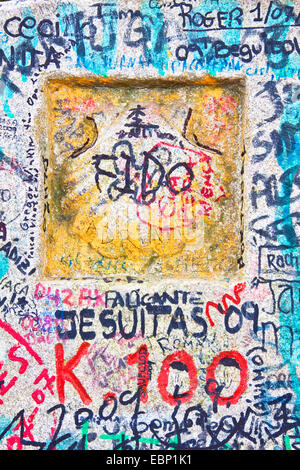Way of St. James, detail of a milestone 100 at the way from Brea to Morgade with lots of pilgrims graffitis, Spain, Galicia, Lugo