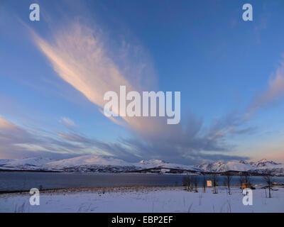 windy clouds over island Kvaloya, Norway, Troms, Tromsoe, Sandnessund - Stock Photo