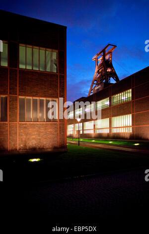 illuminated headgeare 0f coal mine Zollverein, Zeche Zollverein Schacht XII at night, Germany, North Rhine-Westphalia, - Stock Photo