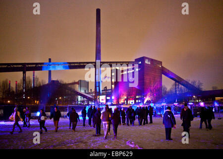 people at the illuminated coking plant of Zollverein during the opening event of European Capital of Culture 2010, - Stock Photo