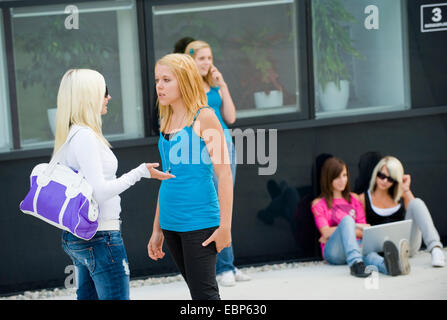 five young girls in the schoolyard - Stock Photo