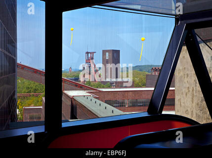 coal mine Zollverein with big yellow balloons over European Capital of Culture Essen marking former sites of coal - Stock Photo