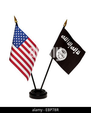 Small flags of the United States and ISIL, ISIS in a stand isolated on a white background. Includes clipping path. - Stock Photo