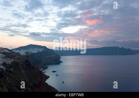 Ia, Santorini, South Aegean, Greece. View across the caldera at dawn, pink clouds in sky. Stock Photo