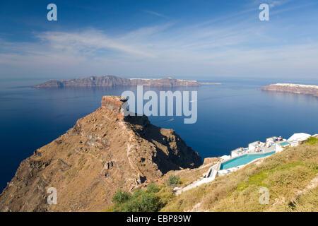 Imerovigli, Santorini, South Aegean, Greece. View from clifftop to Skaros Rock and the distant island of Thirasia. - Stock Photo