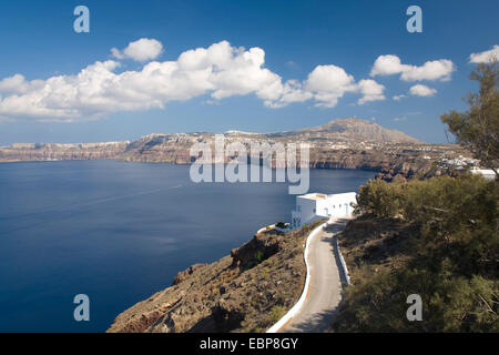 Akrotiri, Santorini, South Aegean, Greece. View along winding coast road high above the deep blue waters of the - Stock Photo
