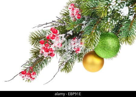 Christmas fir tree branch with holly berry and baubles. Isolated on white background - Stock Photo