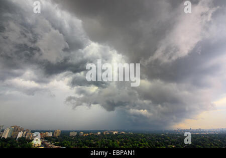 Storm clouds moving over Northern Toronto in summer - Stock Photo