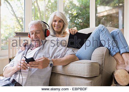 Senior couple relaxing in living room - Stock Photo