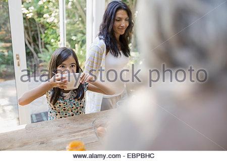 Multi-generation family in kitchen - Stock Photo
