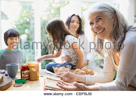 Multi-generation family in kitchen - Stock Photo