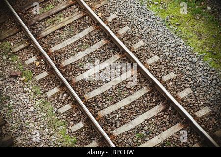 Retro filtered photo of railway tracks background. - Stock Photo