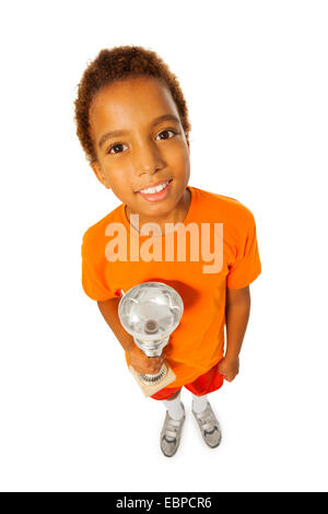 Happy black boy with prize cup - Stock Photo