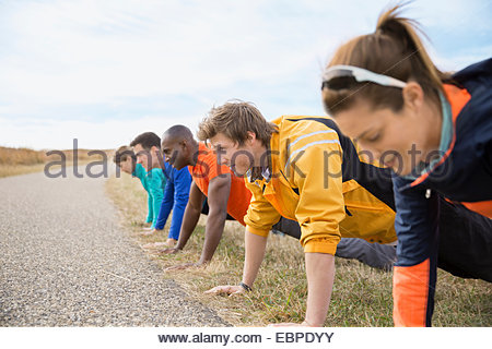 Group doing push-ups in a row - Stock Photo