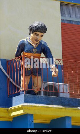 Statue of Diego Maradona in the colourful Caminito street on La Boca in Buenos Aires, Argentina - Stock Photo