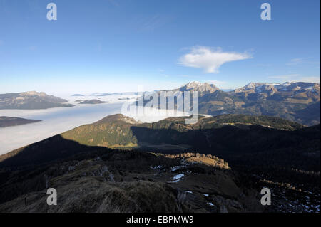 view of sunny Gruenstein and Hoher Goell mountain while the valley is covered with high fog, Ramsau, Berchtesgaden, - Stock Photo
