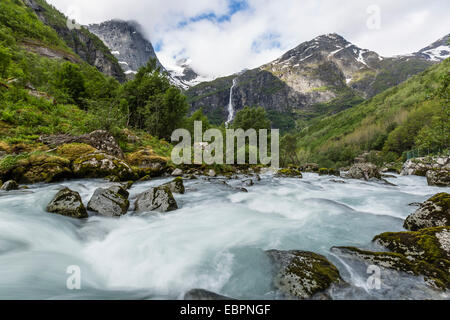 Slow shutter speed silky water of the Olden River as it flows along Briksdalen, Olden, Nordfjord, Norway, Scandinavia, - Stock Photo