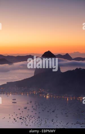 Sugarloaf Mountain (Pao de Acucar) at dawn, Rio de Janeiro, Brazil, South America - Stock Photo