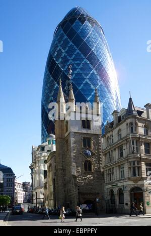 30 St Mary Axe (The Gherkin) with St. Andrew Undershaft church, City of London, England, United Kingdom, Europe - Stock Photo