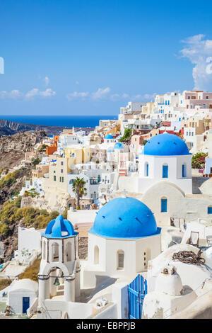 Greek church with three blue domes in the village of Oia, Santorini (Thira), Cyclades Islands, Greek Islands, Greece, - Stock Photo