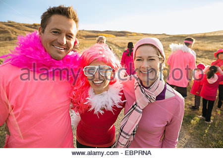 Portrait of friends in pink at charity race - Stock Photo