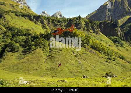 training for a Mountain rescue with a helicopter, Germany, Bavaria, Allgaeu Alps, Oytal - Stock Photo