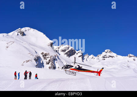 rescue helicopter landing after skiing accident, France, Savoie - Stock Photo