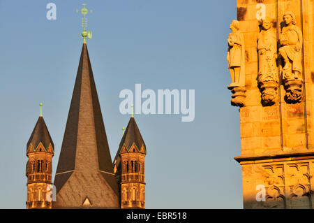 sculptures at the townhall tower, steeple gross St Martin in the background, Germany, North Rhine-Westphalia, Cologne - Stock Photo