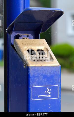 ashtray at a busstop, Germany - Stock Photo